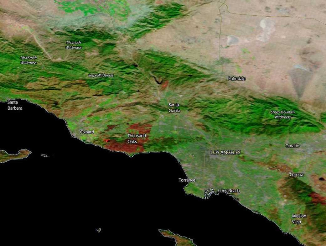 NASA's Terra satellite captured this image of the Woolsey Fire burn scar Nov. 14, 2018 in Ventura and Los Angeles counties. The red areas near Thousand Oaks and south to Malibu indicate the burn area. The brighter red spot between Oxnard and Thousand Oaks denotes an area of active fire.