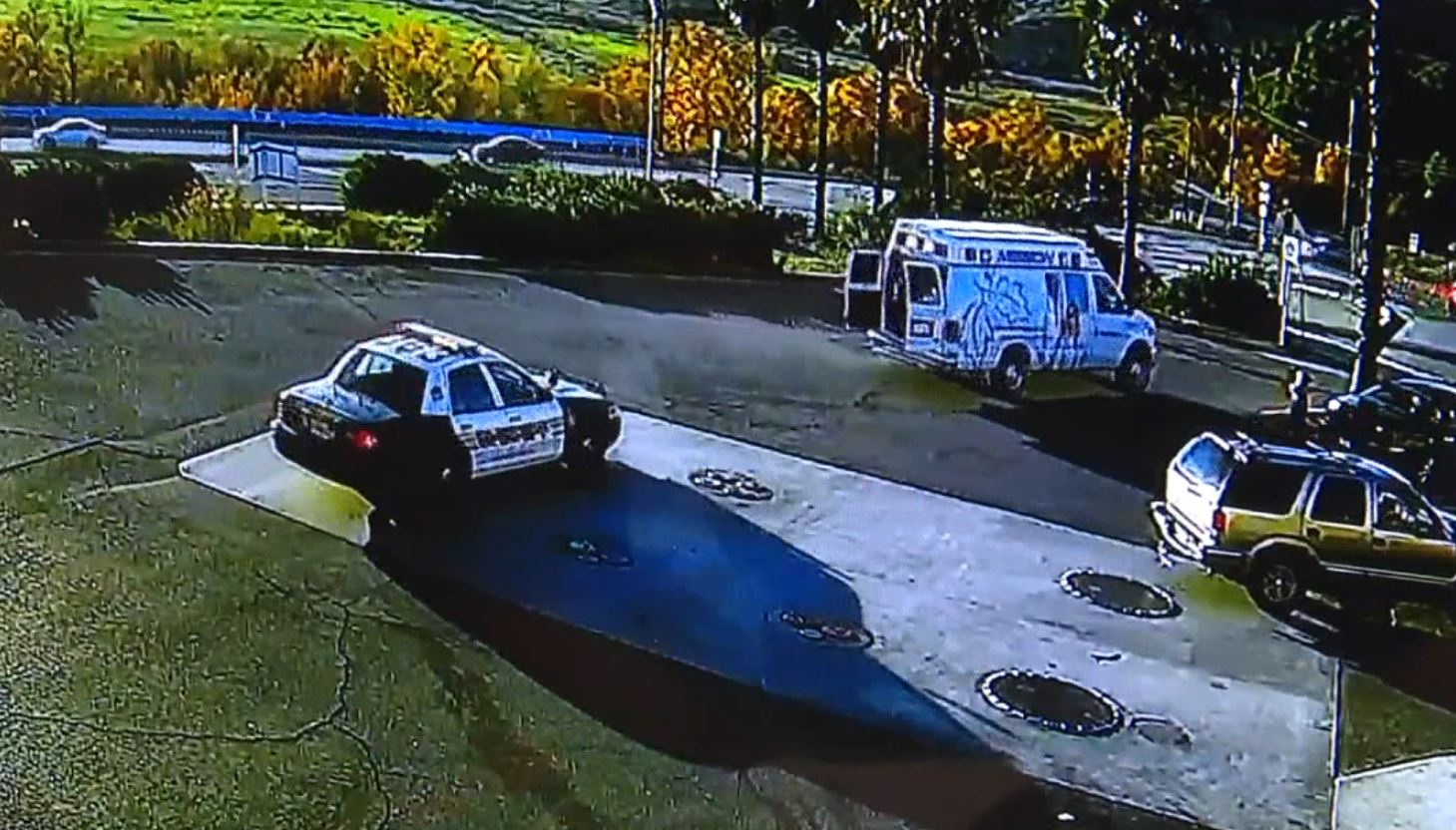 Security camera video shows a sheriff's department patrol car chasing a stolen ambulance Sunday Dec. 16, 2018 in a convenience store parking lot.