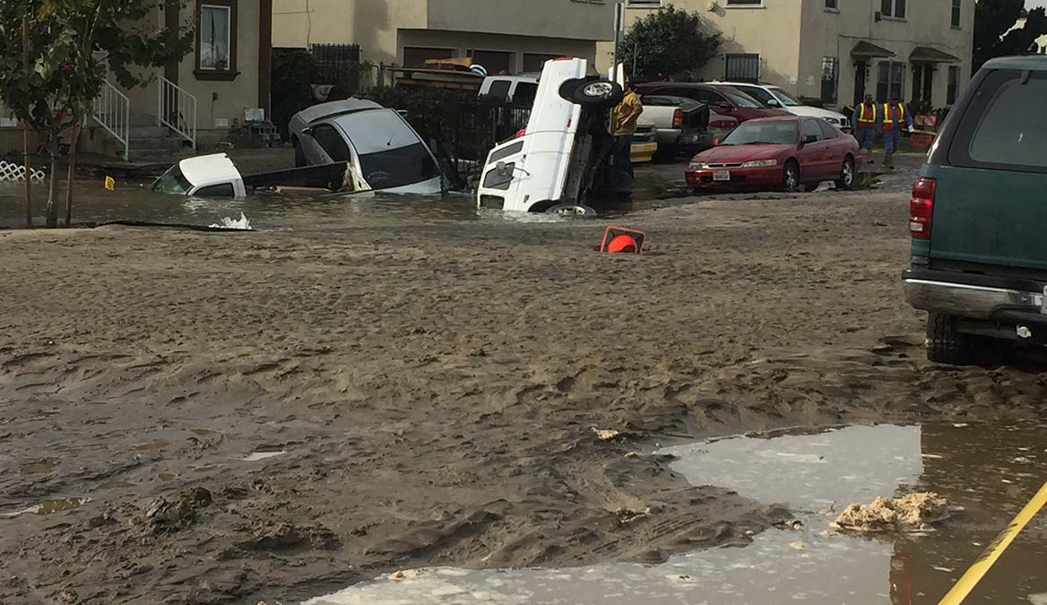 A pickup is partially submerged in water due to a water main break Friday Dec. 21, 2018 in South Los Angeles.