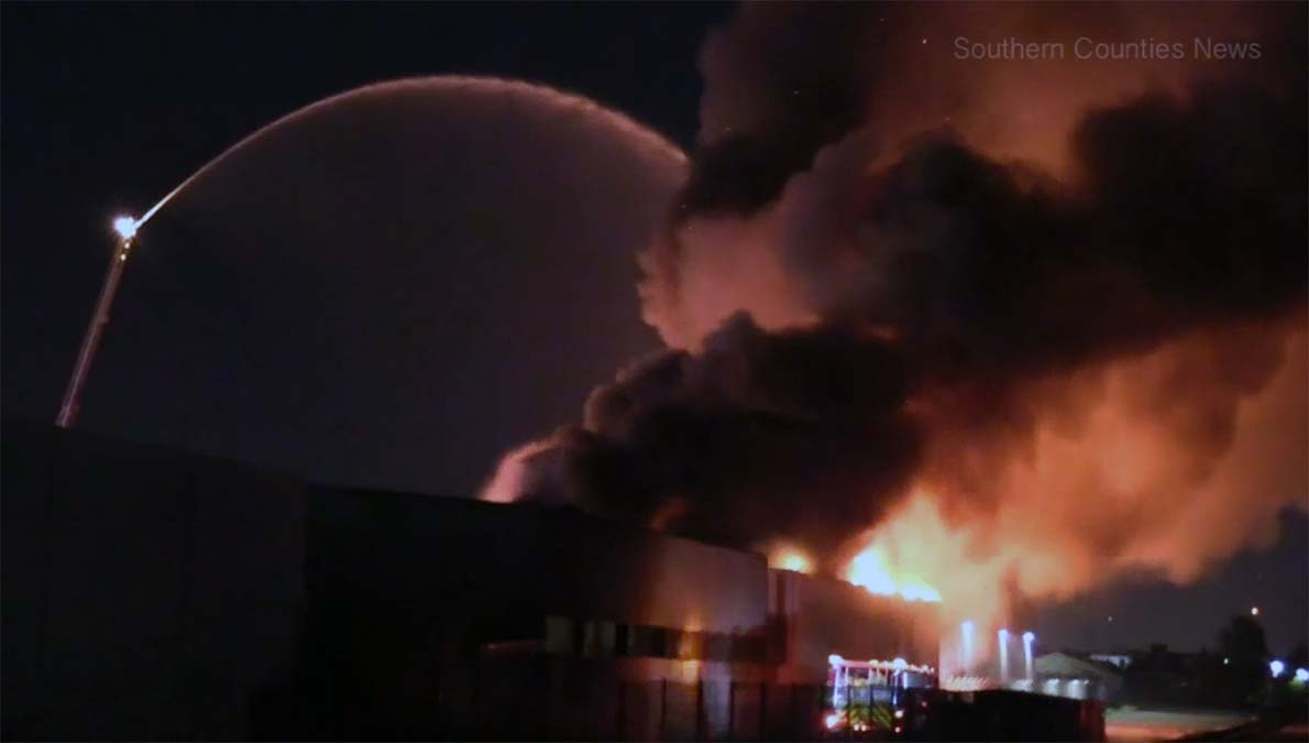Smoke rises from a metal shop fire Wednesday Dec. 26, 2018 in Orange.