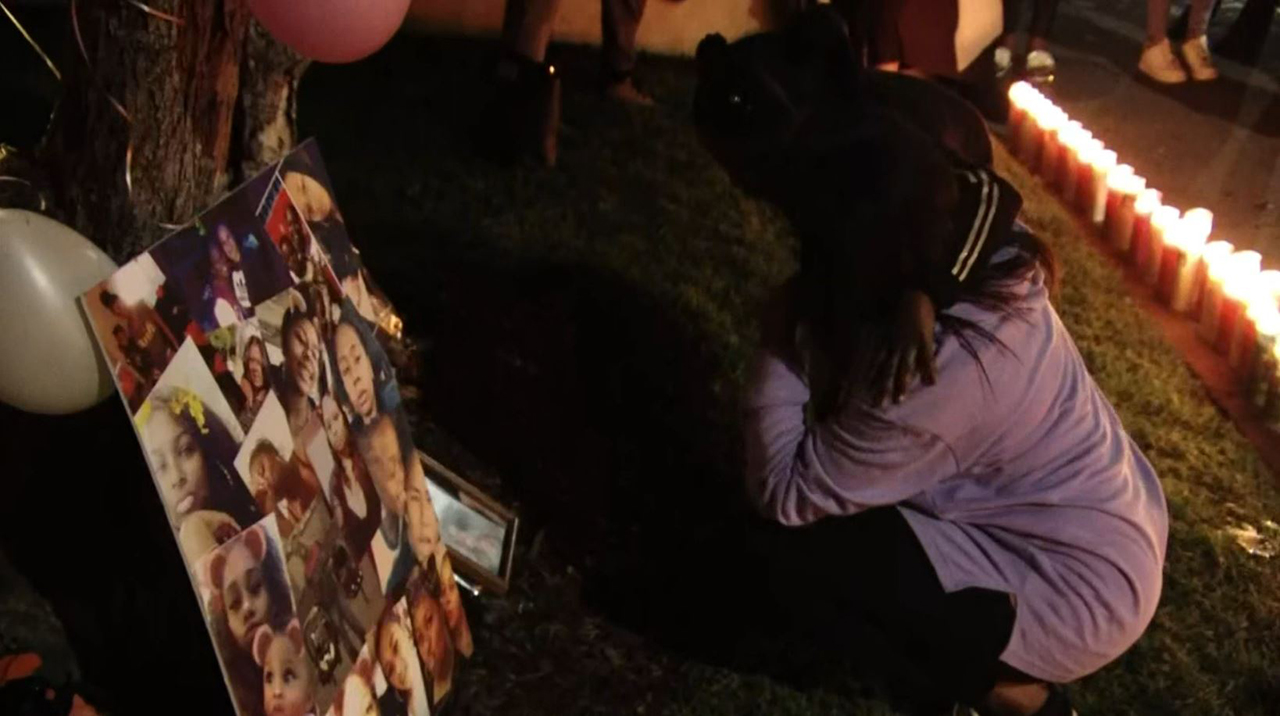 Mourners gather to remember Uniek Atkins, 27, and her sister Sierra Brown, 16, on Tuesday, Nov. 20, 2018. Both sisters were found shot to death after firefighters put out a blaze in their apartment on Saturday, Nov. 17, 2018.