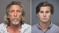 Dad, Son Accused of Beating Officer