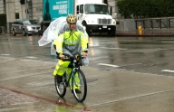 Man Braves the Rain in Downtown LA