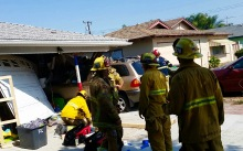 Driver Hospitalized After Crashing Into House