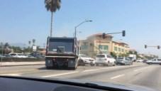 WATCH: Runaway Gravel Truck Careens Off Cars, Median
