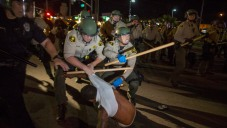 Fourth Night of Protests Over Police Shooting Heat Up in...