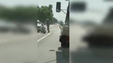 BMW Plows Vehicle Into Motorcycle, Speeds Off