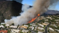 Watch: The Palisades Fire as Seen From a Water-Dropping Helicopter