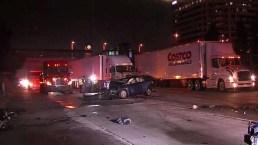 Photos: FedEx Big Rig Crash, Spills Contents on Rail Line