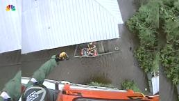 US Coast Guard Helicopter Rescues People From Floodwaters