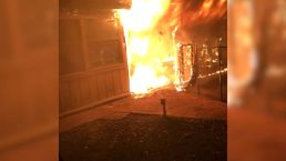 Neighbors, Dog Help Save Family From Burning Home