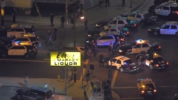 Crowd Gathers in Street After Police Traffic Stop and Fatal Shooting