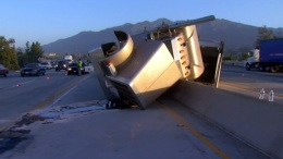 Big Rig Carrying Grapes Crashes Into Freeway Divider