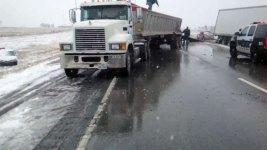 13 Cars, 2 Semis Slide Off Texas Highway in Snowstorm