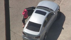 Pink Hoodie-Clad Driver Narrowly Avoids Hitting Girl During Chase
