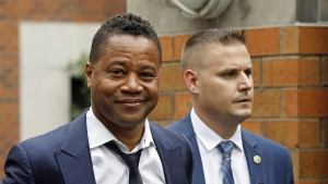 Smirking Cuba Gooding Jr. Charged in Rooftop Bar Grope Case