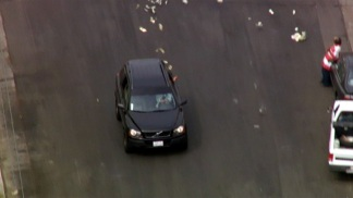 Raw Video: Cash Tossed During SUV Pursuit