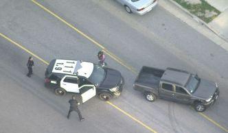 Pursuit Suspect Attempts to Jump in Cop Car