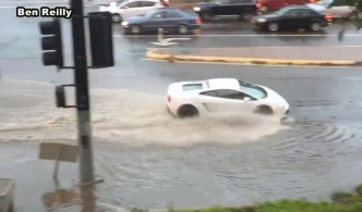 Lamborghini Goes for Dip in Flooded Intersection