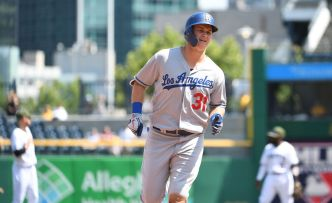 Dodgers Use Record 9 Relievers in Win Over Pirates
