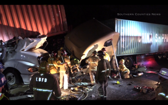 Two Injured When Three Big Rigs Crash on 710 Freeway