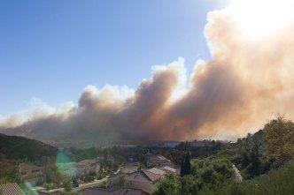 Wind-Driven Rye Fire Contained by 50 Percent