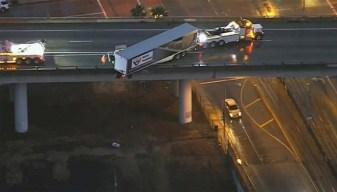 Big Rig Hangs Precariously on Freeway Overpass in East LA