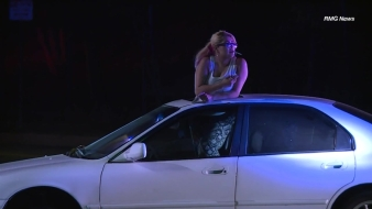 Woman Casually Smokes Cigarette During Pursuit Standoff