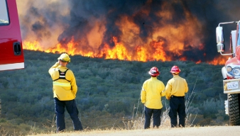 """Crews Defend Homes From """"Wall of Flame"""""""