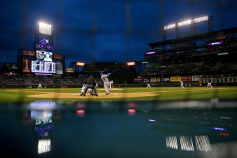 Dodgers Top Rockies 2-1 in Rain-shortened Game