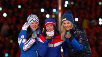 Bjorgen Receives Olympic Medal #15 at the Closing Ceremony