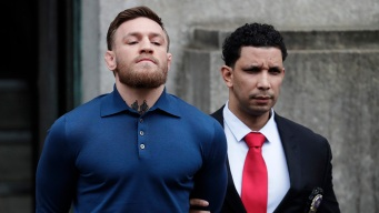 Raw Video: MMA Fighter Conor McGregor Led Away After Arrest