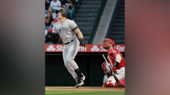 Voit Homers Twice to Lead Yankees Over Angels 7-5