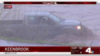 Crews Work to Rescue Stranded Motorist