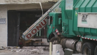 Watch: Sanitation Truck Removed From Donuts Depot