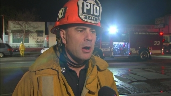 Firefighters Rescue Children From Burning Home
