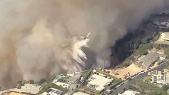 Firefighters Battle Flames in Pacific Palisades