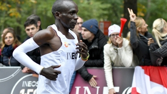 Kenyan Runner First Under 2 Hours for Marathon But No Record
