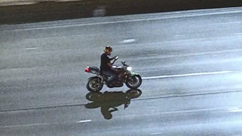 Motorcycle Driver Pulls Out Phone During High-Speed Pursuit