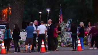 Mourners Pay Tribute at Borderline Bar Memorial