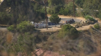 Online Extra: Mulholland Residents Angered by Tour Influx