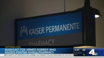 Police Search for Armed Robber Who Raided Pharmacy
