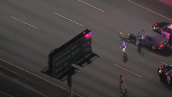 Police Pursuit Ends on 101 Freeway with Suspect Running