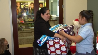 Santa Brings Presents to Children from Low-Income Families