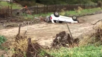Man Helps Rescue Driver Stranded in SUV