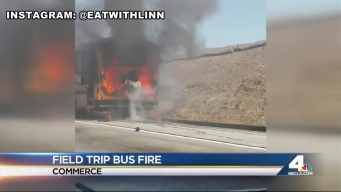 School Bus Catches Fire on Freeway
