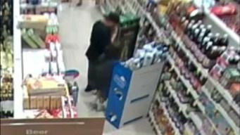 Watch: Shoplifter Stuff Bottle of Booze Down Pants