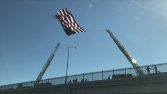 Mourners Honor Slain Firefighter During Procession
