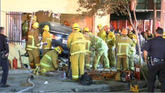 Child Dies After Car Slams Into South LA Apartment Building