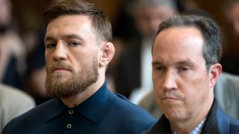 Handcuffed Conor McGregor Answers to Charges in NYC Melee
